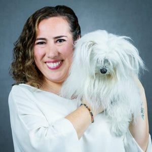 Cynthia Luna holding a Dog