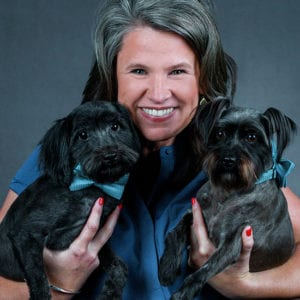 Jennifer Hooten holding two Dogs