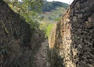 Hiking path between two walls of rocks